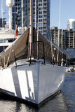 Luxury sailboat in port. A luxury sailboat moored in an urban harbour Royalty Free Stock Photos