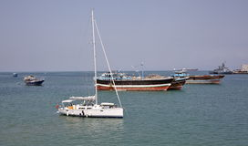 Luxury sailing boat, fishing and cargo ships at anchor in the port of Djibouti Stock Photography