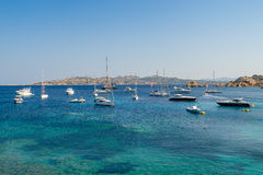 Luxury sailing and motor yachts at scenic Porto Massimo bay Stock Photography