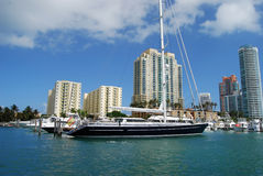 Luxury Sailing Yacht. 165 foot sailing yacht moored at the Miami Beach Marina with highrise luxury condominiums in the background Stock Photos