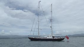 Luxury sailing yacht anchored at sea. Side view stock video footage