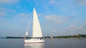 Luxury sailing yacht on city river, vacation, holiday, hobby. Stock footage stock video