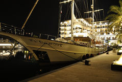 Luxury sailing yacht at night. TIVAT, MONTENEGRO – AUGUST 9th, 2015: Luxury sailing yacht at night in the Porto Montenegro. Porto Montenegro is a luxury part Royalty Free Stock Photo