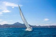Luxury sailing yacht in the wind through the waves at the Aegean Sea. Sport. Royalty Free Stock Photo