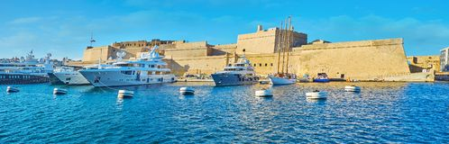 Yachts at Fort St Angelo, Birgu, Malta. The luxury sailing yachts are moored at the Fort St Angelo in Vittoriosa Marina, located between fortified cities of Stock Photo