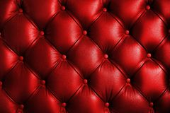 Saturated glossy red leather texture of sofa chair stock photos