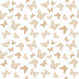 Luxury seamless pattern background with golden filigree butterflies isolated on white. Royalty Free Stock Photography