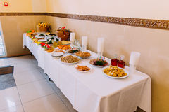 Luxury served catering table of different salty snacks along with other food Stock Photography