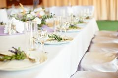 Luxury served wedding dinning table for guests royalty free stock photography