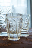 Luxury set of crystal glass on a decorated cover Royalty Free Stock Photography