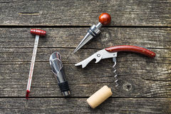 Luxury set of tools for winery. Luxury set of tools for winery on wooden table Royalty Free Stock Image