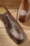 Luxury shoes 03. Two per brown luxury shoes Stock Photos