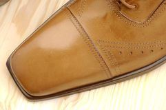 Luxury shoes 21. Brown luxury shoes and wood Royalty Free Stock Images