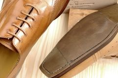 Luxury shoes 22. Brown luxury shoes and wood Stock Images