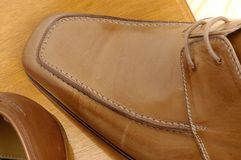 Luxury shoes 23. Brown luxury shoes and wood Royalty Free Stock Image