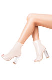 Luxury shoes with high heels on perfect legs over white backgrou Royalty Free Stock Images
