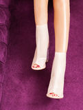 Luxury shoes with high heels on perfect legs Royalty Free Stock Photo