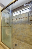 Luxury shower with tile and removable shower head. Stock Image