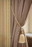 Luxury silk curtain and tassel Stock Photography