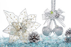 Luxury Silver jingle Bells, flower and Pine Cone on Snow Royalty Free Stock Photography