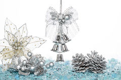 Luxury Silver jingle Bells, flower and Pine Cone on Snow Stock Images