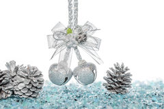 Luxury Silver jingle Bells and Pine Cone on Snow Stock Photos