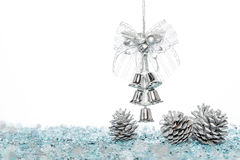 Luxury Silver jingle Bells with Snow and Pine Cone Stock Images