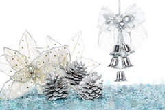 Luxury Silver jingle Bells with Snow and Pine Cone Royalty Free Stock Image