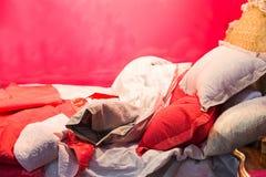 Luxury sleeping bed. Red luxury sleeping bed close up stock photos