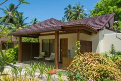 Luxury small living house on the beach located at the tropical island Royalty Free Stock Photo