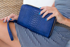 Luxury snakeskin wallet purse in woman hands. Bali island, handmade purse, fashion. Stock Photos