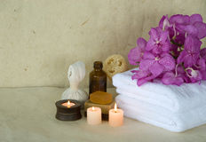 Luxury soap 2. Handmade spa soap and loofah natural sponge with candles and towels Stock Photography
