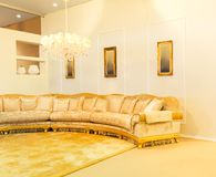 Luxury sofa in beige fashion interior Royalty Free Stock Photography