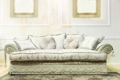 Luxury sofa in beige fashion interior royalty free stock photos