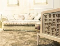 Luxury sofa in beige fashion interior Stock Images