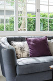 Luxury sofa in living room with sunlight Stock Image