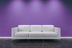 Luxury sofa. White luxury sofa on a violet background with ambient lights Stock Images
