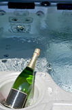 Luxury spa. Close-up of the luxury spa bath with big bottle of champagne Stock Photo