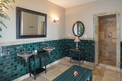 Luxury spa bathroom with limestone tile and shower stock image