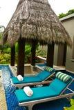 Luxury spa outodoor bathtub and sunbeds Stock Photo