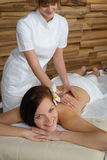 Luxury spa room woman back massage Royalty Free Stock Photography