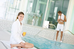 Luxury spa - young woman relax on poolside Stock Images