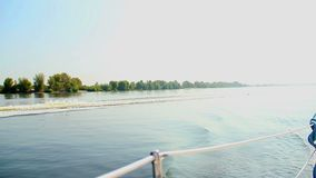 Luxury speed boat on wide river, summer, vacation, yachting POV. Stock footage stock video footage