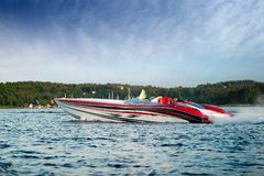 Luxury Speedboat. A very large speedboat crusing on a lake Stock Photos