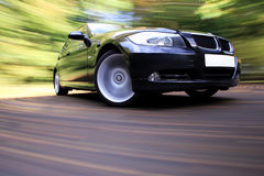 Luxury sport car in fast drive Royalty Free Stock Photography