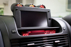 Luxury Sport Car foldable TV screen on front console. Stock Photo