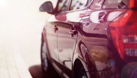 Luxury sport car rides on the road. View side Royalty Free Stock Photo