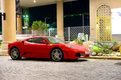 The luxury sport car is on the Walk at Jumeirah Beach Residence Stock Images