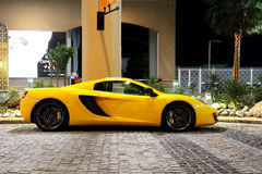 The luxury sport car is on the Walk at Jumeirah Beach Residence Royalty Free Stock Photography
