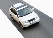 Luxury sport crossovк suv car. Luxury white sport crossover suv car speed on road Royalty Free Stock Images